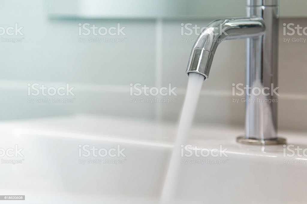 Faucet and water stock photo