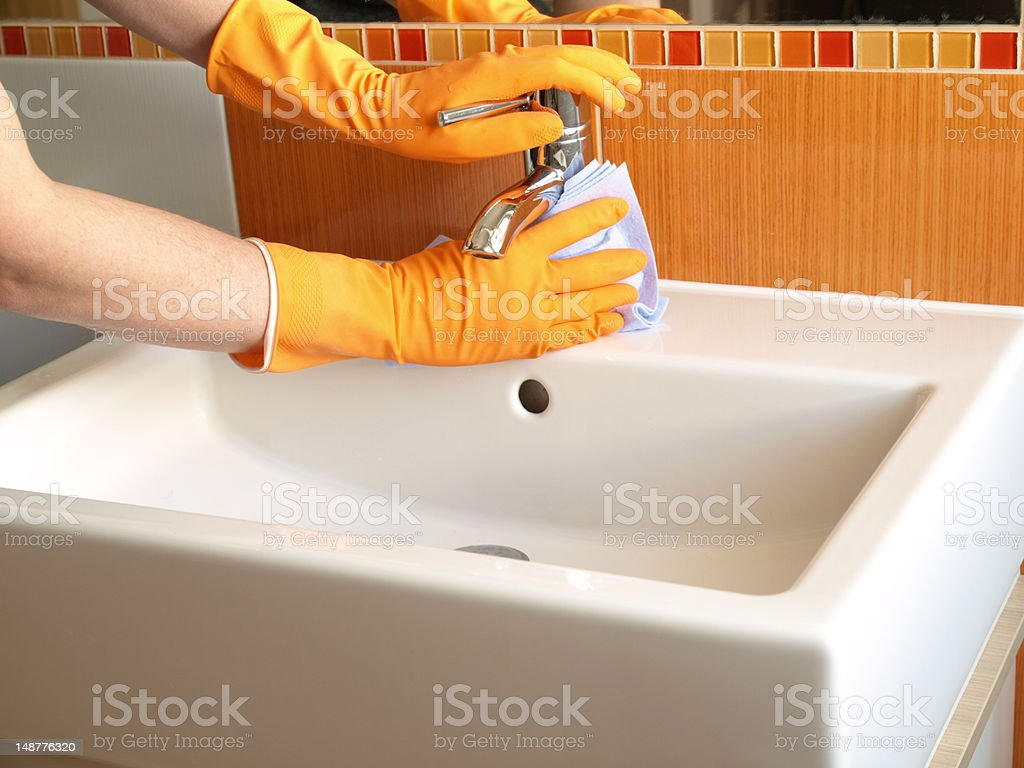 Faucet cleaning royalty-free stock photo