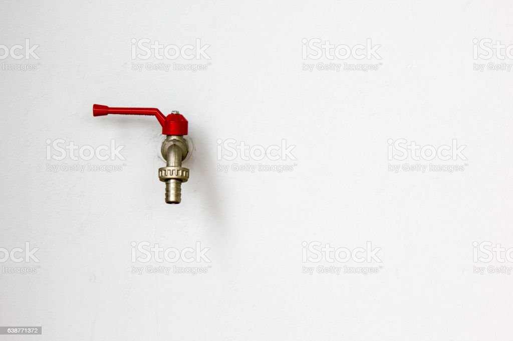 Faucet on wall stock photo