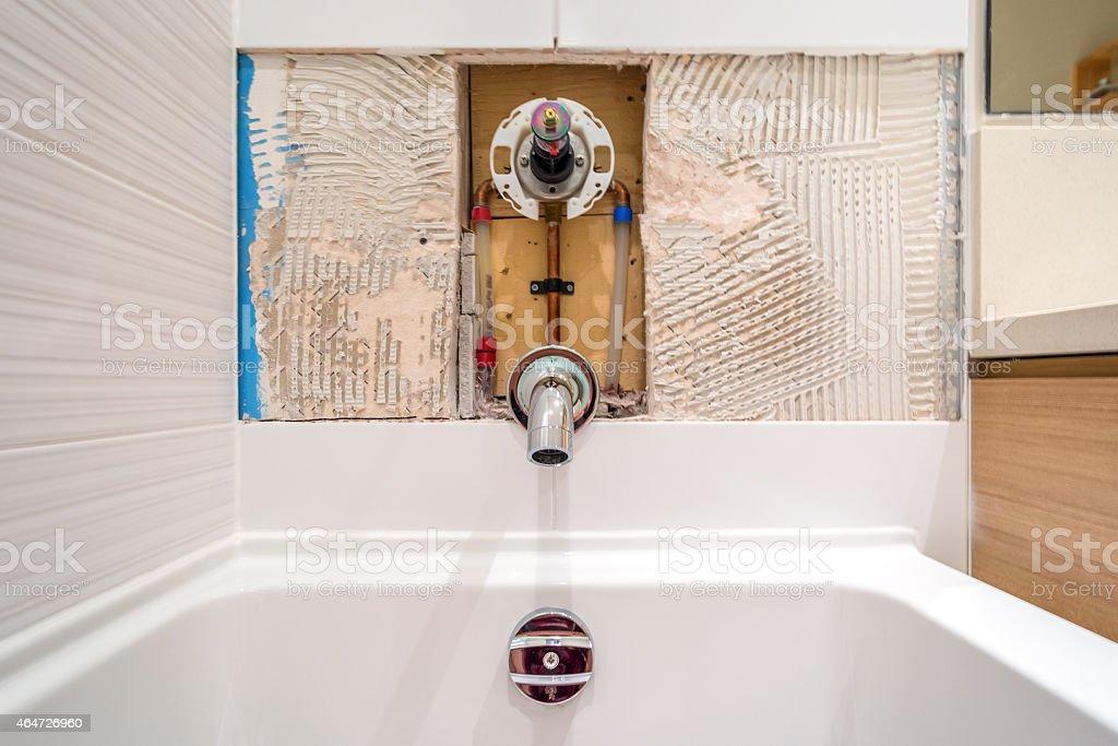 Faucet repair in the bathroom. Broken shower faucet. stock photo