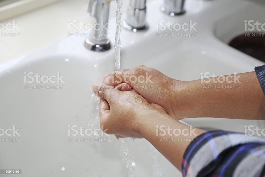 Faucet Water Running Onto Hands royalty-free stock photo