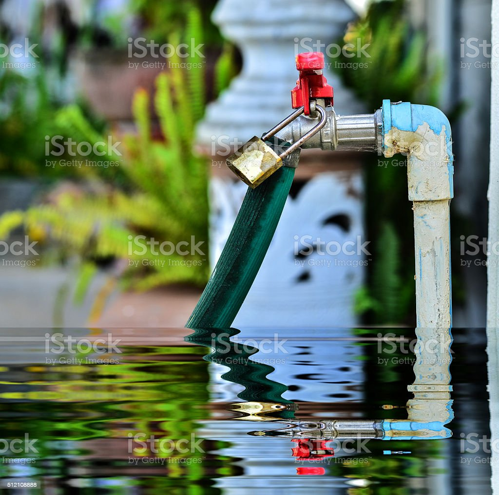 faucet water with lock stock photo