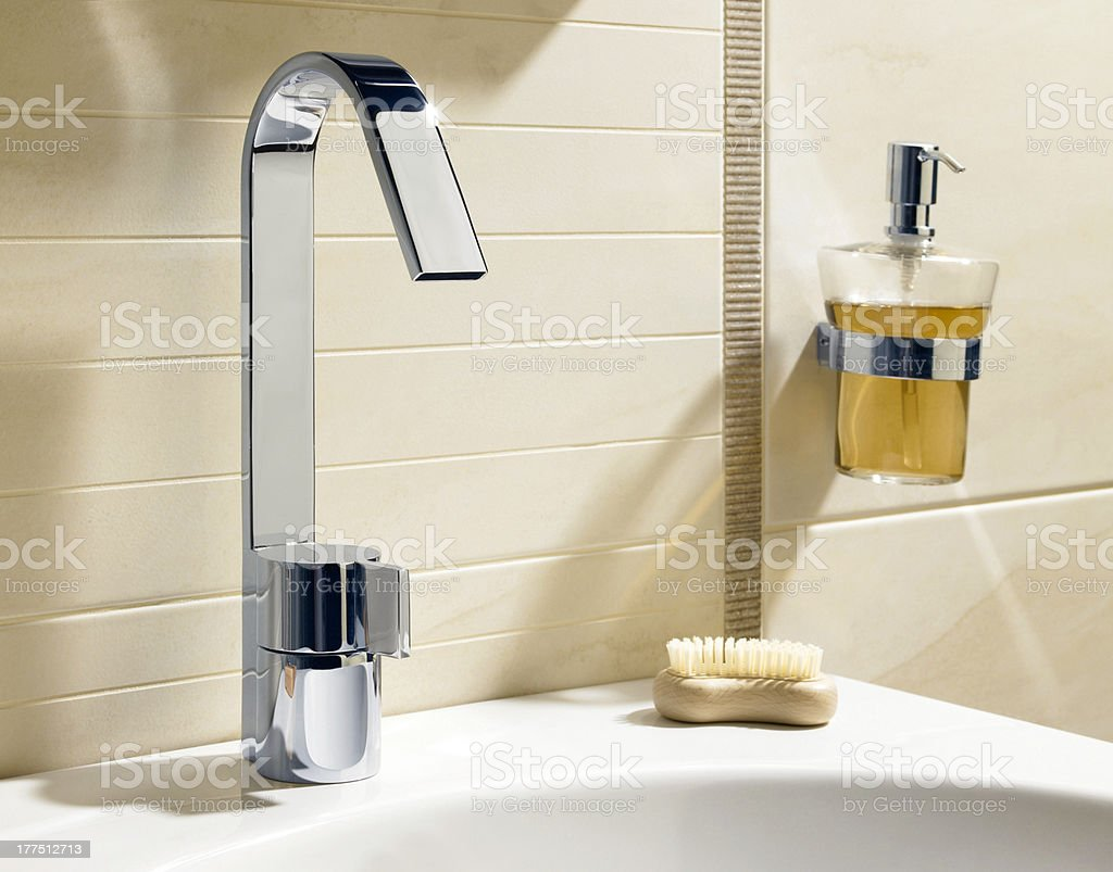 Faucet with liquid soap and brush stock photo