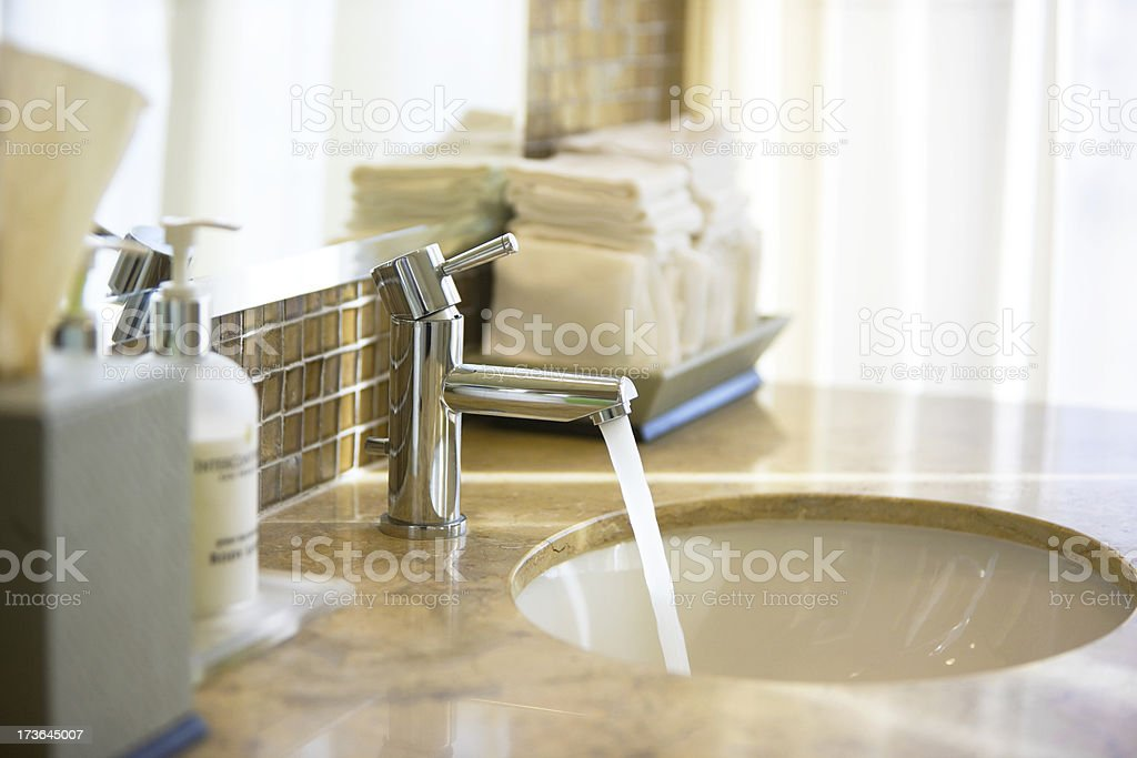 Faucet with running water stock photo
