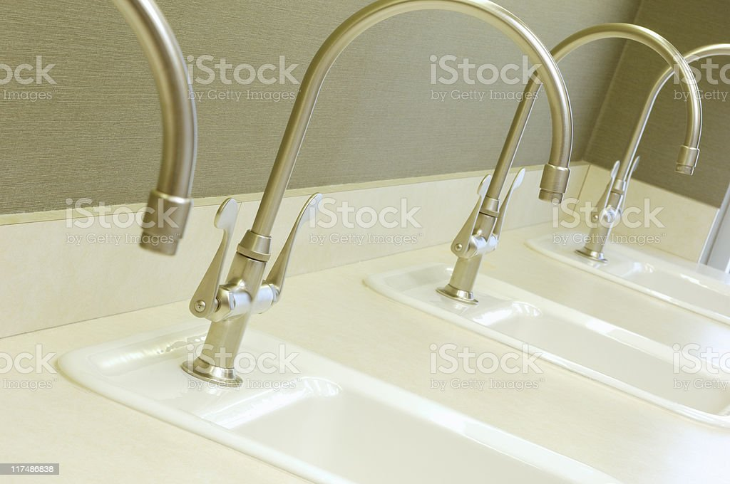 Faucets in a line stock photo