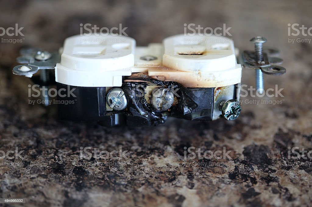 Faulty Burned Electrical Outlet stock photo