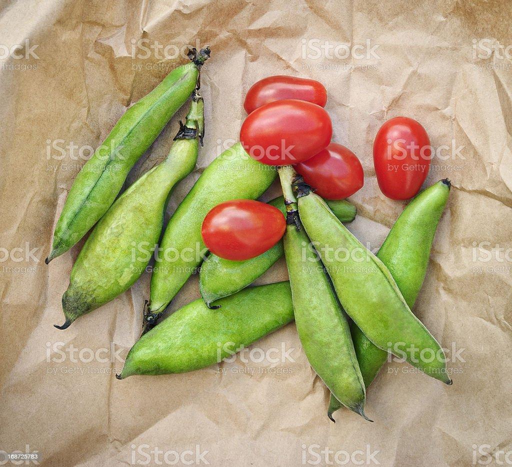 Fava beans & tomatoes stock photo