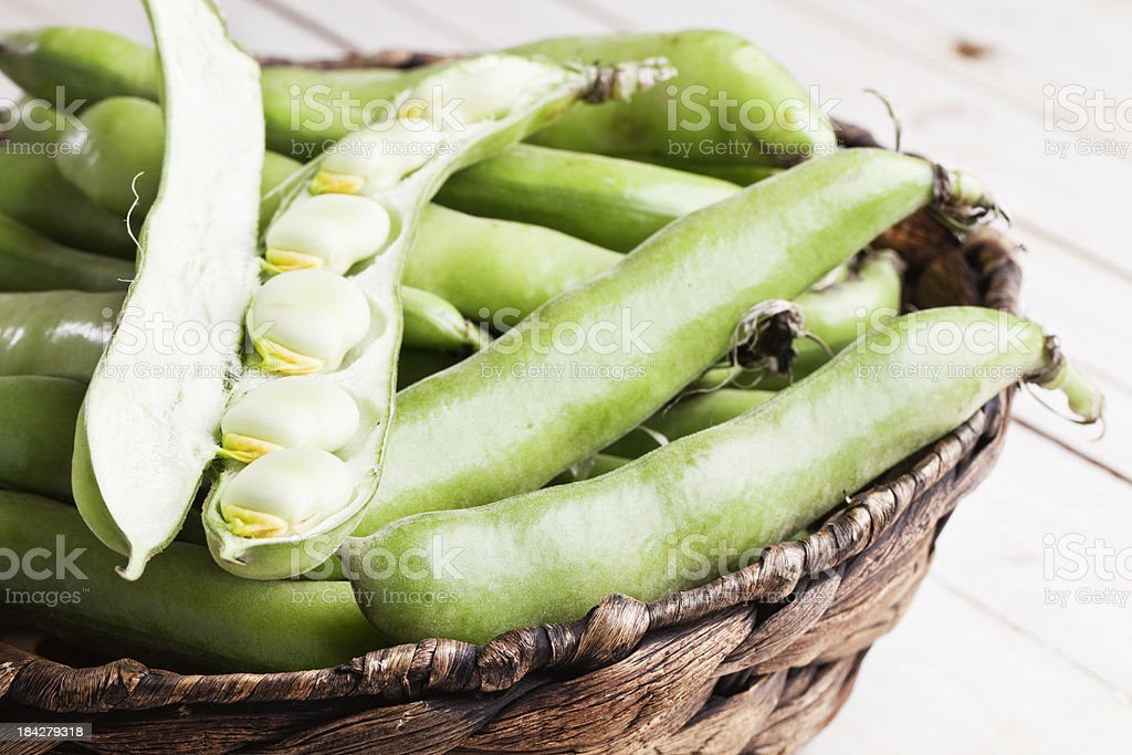 fava beans in basket open pod stock photo