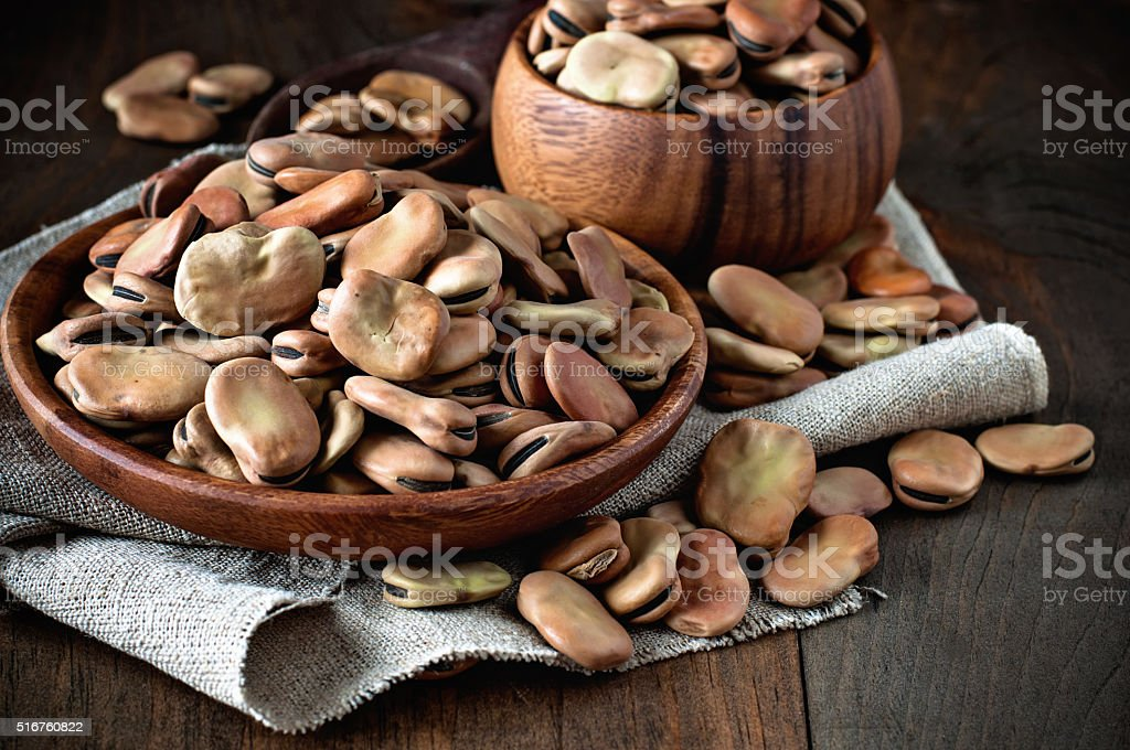 Fava beans in wooden bowls. Rustic style. stock photo