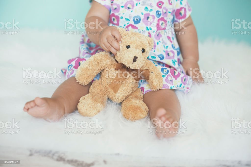Favorite baby girl's toy stock photo