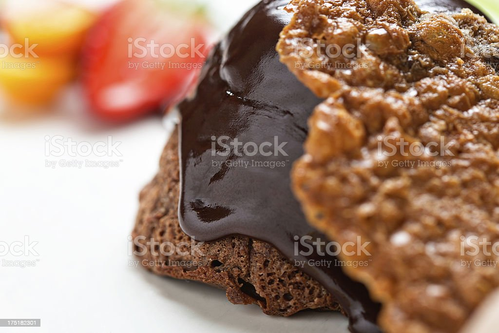 Favourite dessert: hot chocolate fondant with almond florentine and fruit royalty-free stock photo