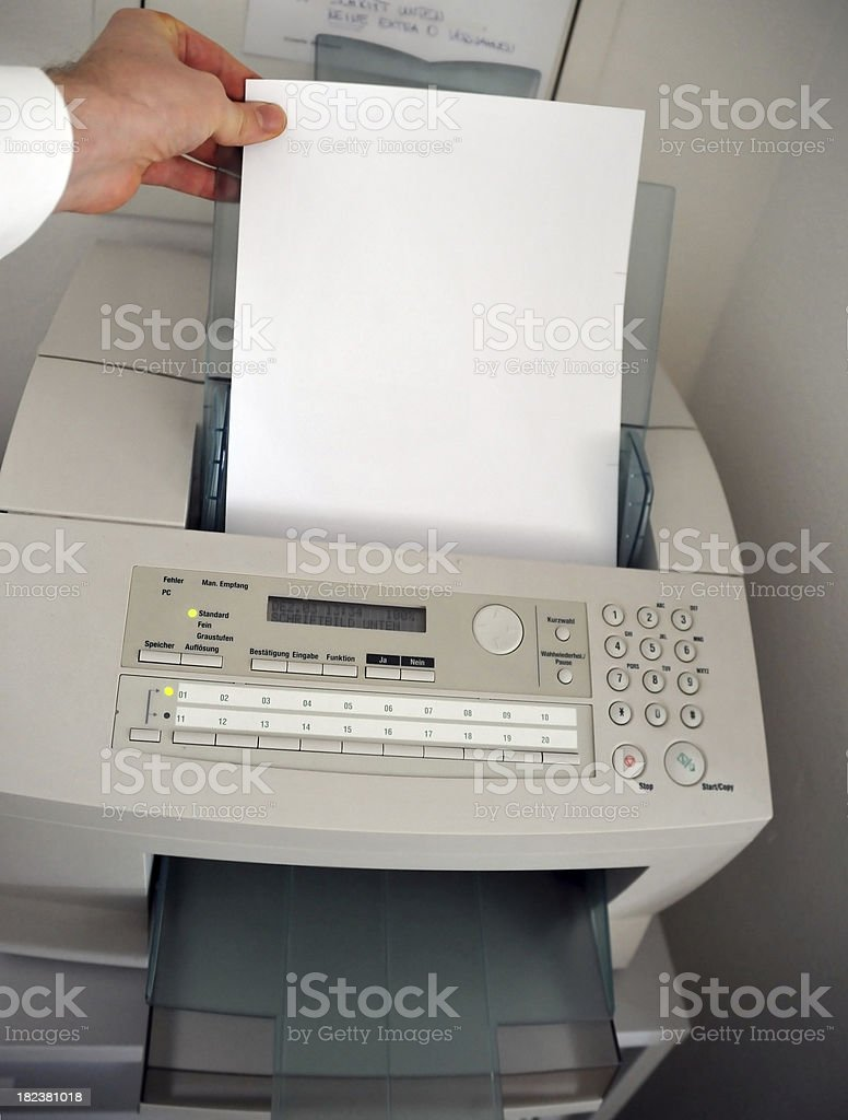 fax machine with hand and copyspace stock photo