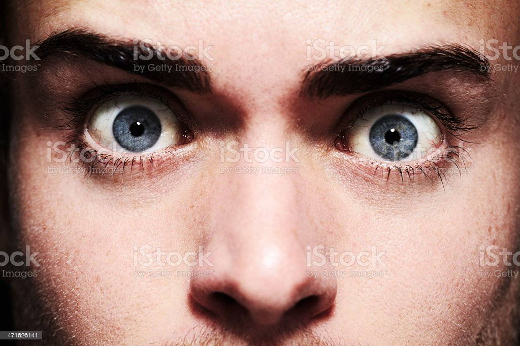 Fear in his eyes stock photo