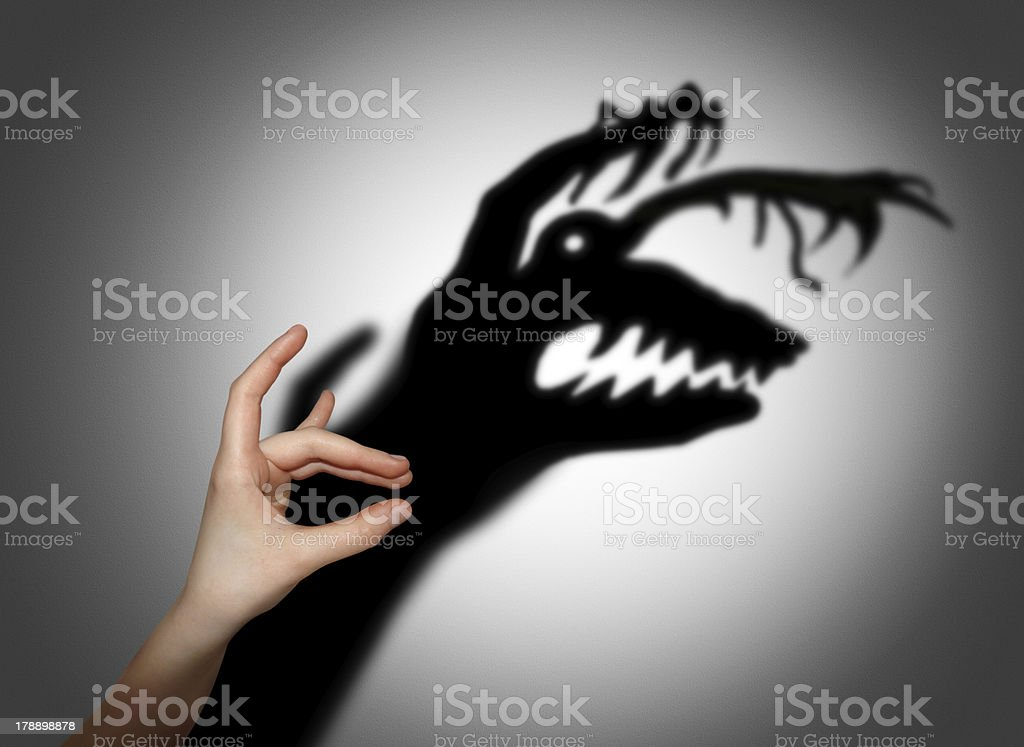 Fear, shadow on the wall stock photo