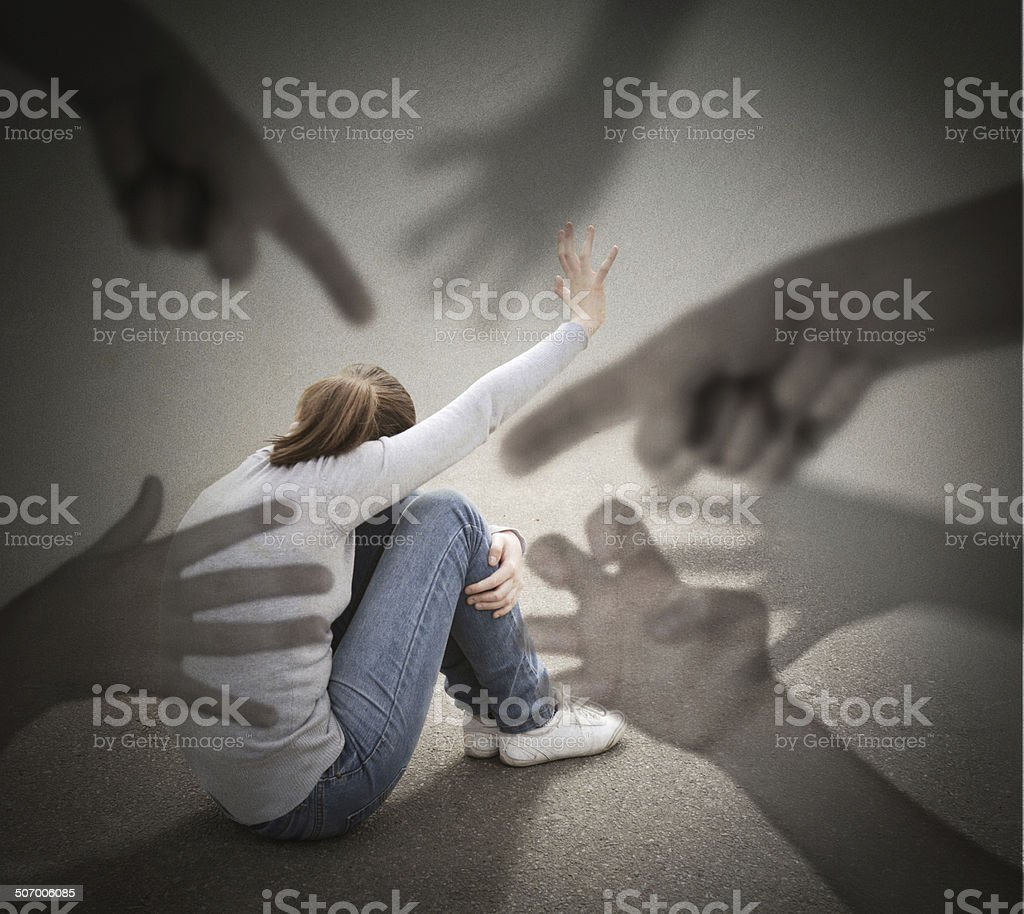 Fear. Young woman is afraid of a imaginary hands. stock photo