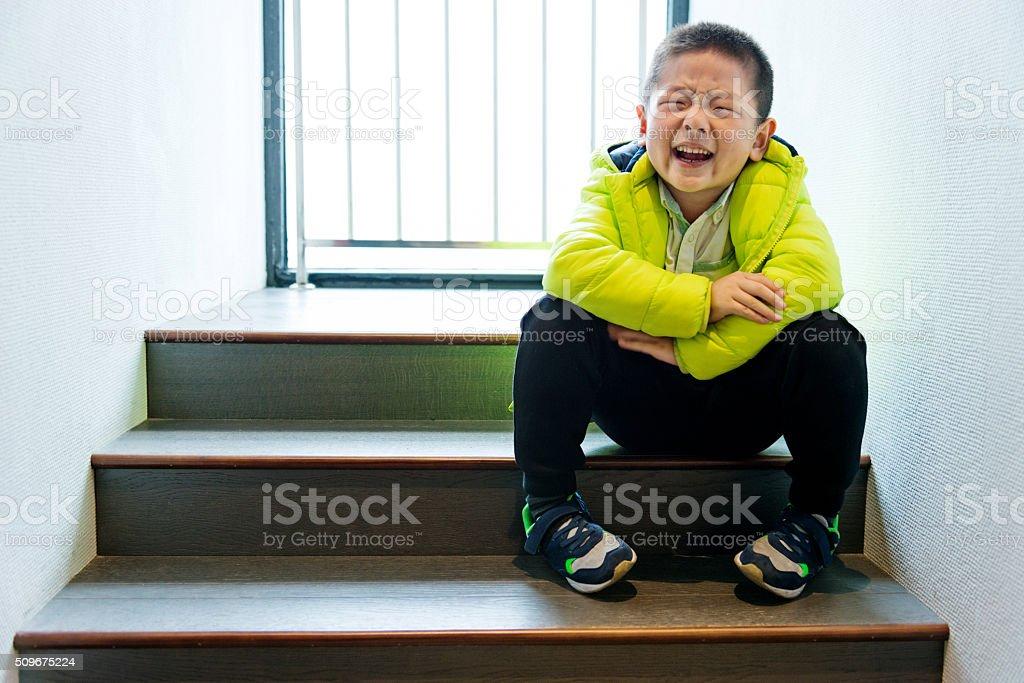 Fearful little boy stock photo