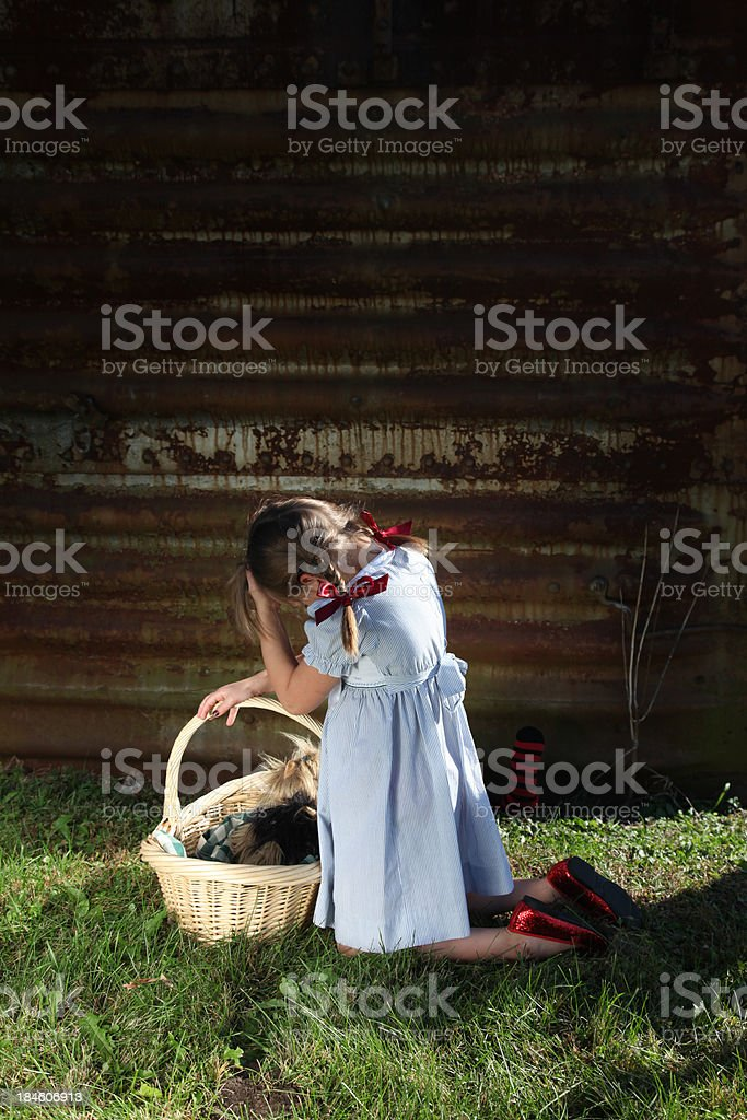 Fearful little girl with dark shadow looming. stock photo