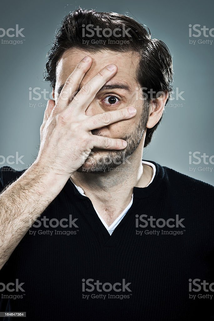 Fearful man with a hand in his face royalty-free stock photo