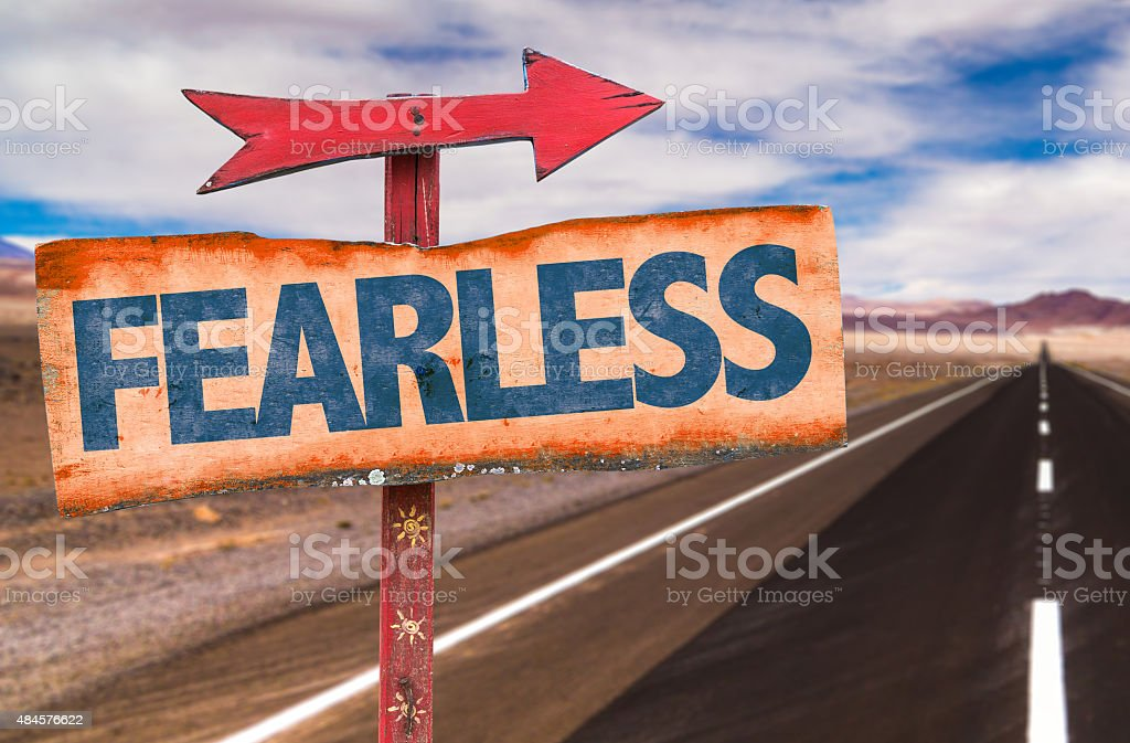 Fearless sign with road background stock photo