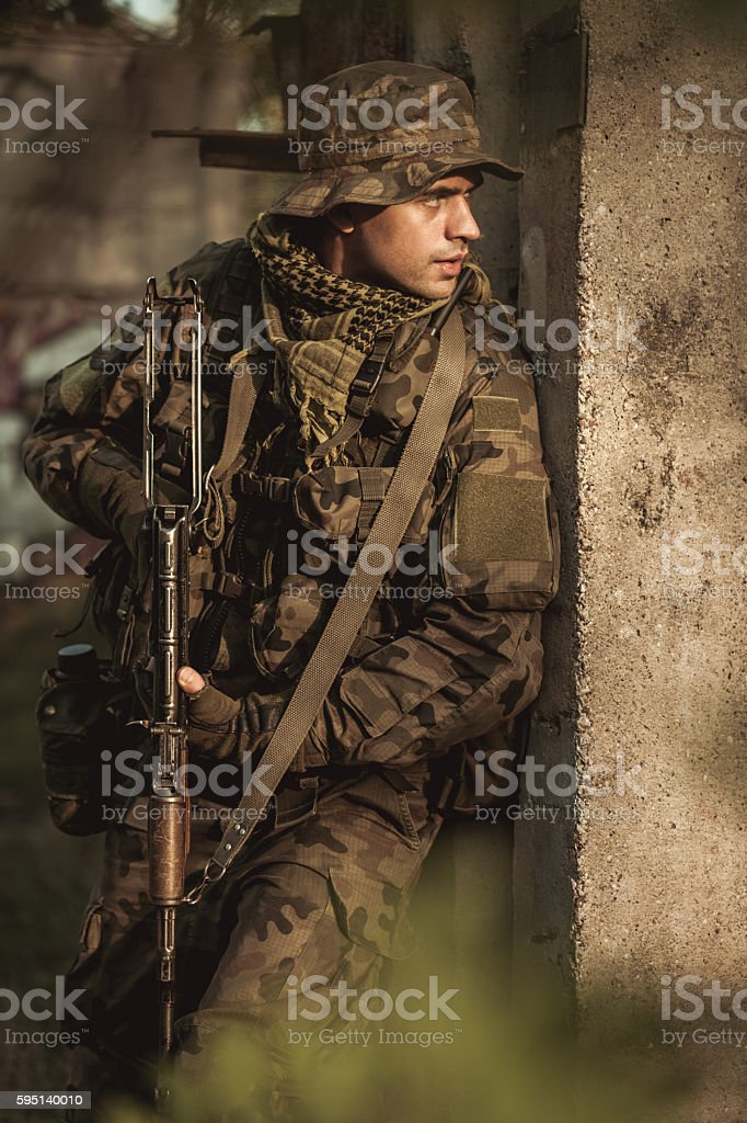 Fearless soldier in action stock photo