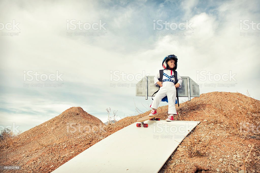 Fearless young boy testing the limits of flight stock photo