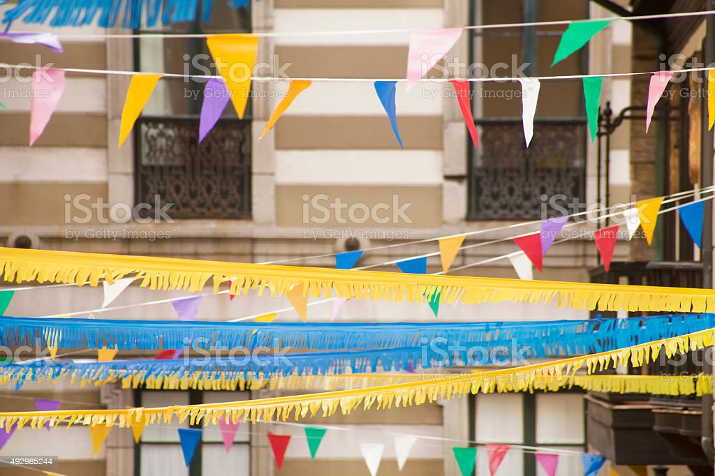 Feast decorations, streamers and bunting in old town stock photo