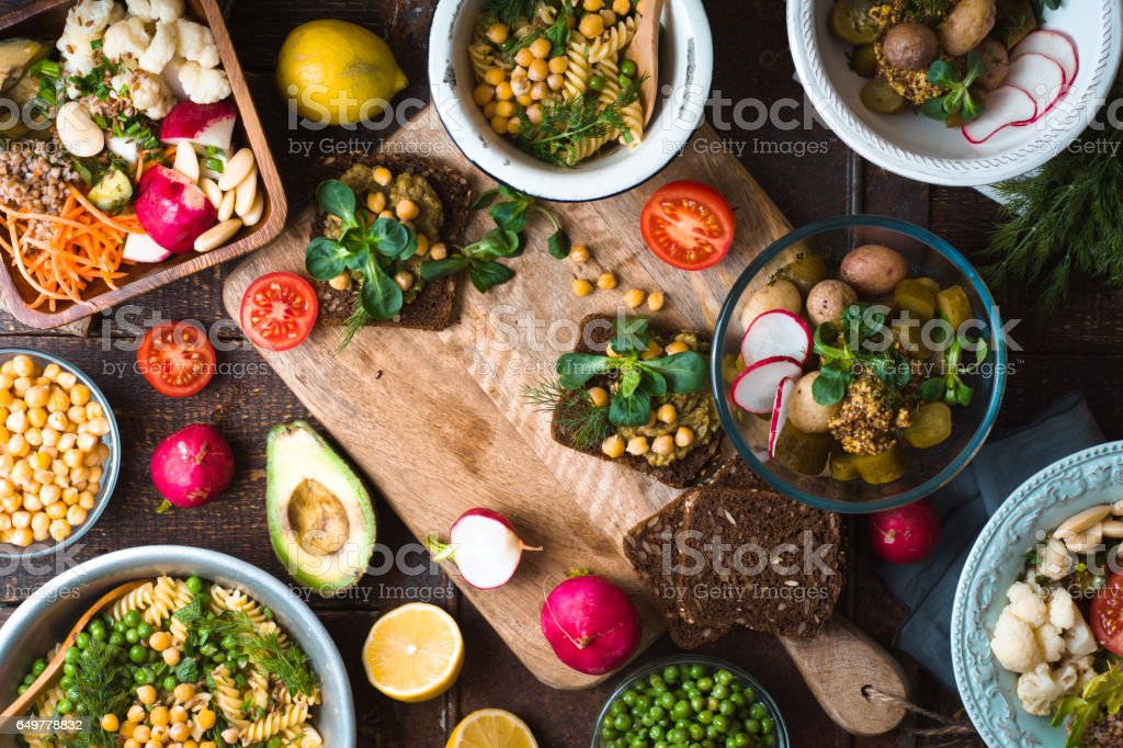 Feast with various salads and sandwiches stock photo