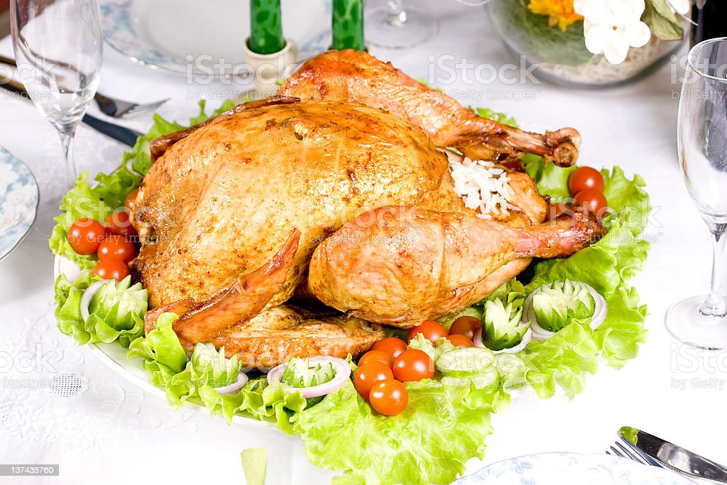Feasting backed turkey on holiday table ready to eat royalty-free stock photo