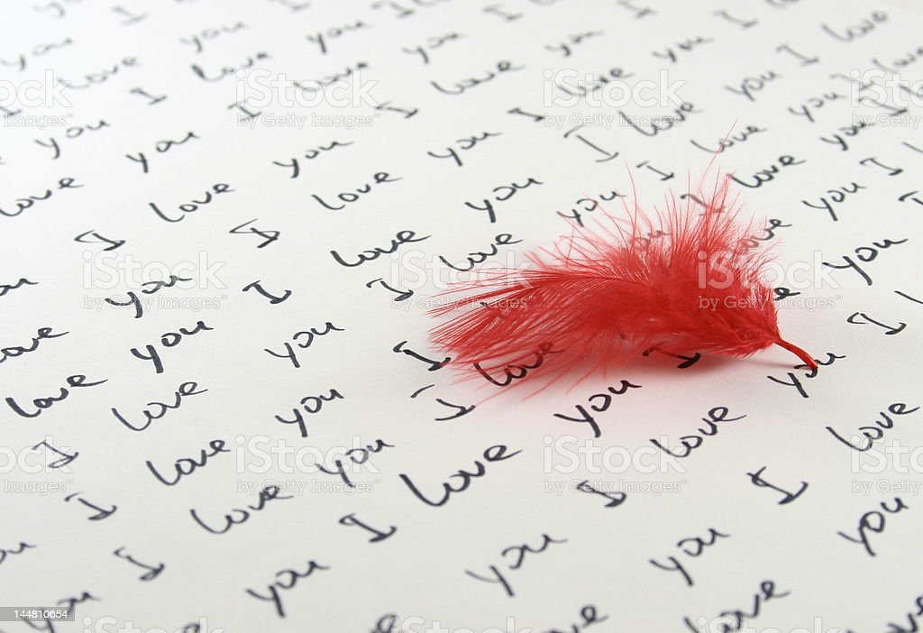 feather and handwritten love letter royalty-free stock photo