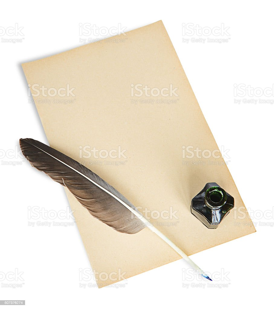 Feather, ink and sheet of old paper stock photo