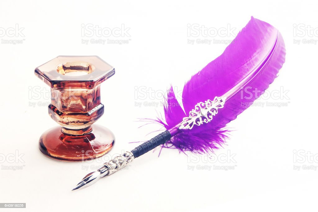 Feather pen and ink bottle stock photo