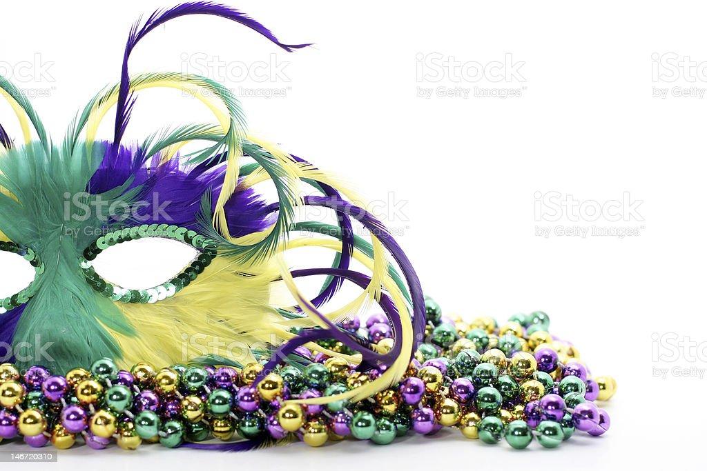 feathered mask on beads stock photo