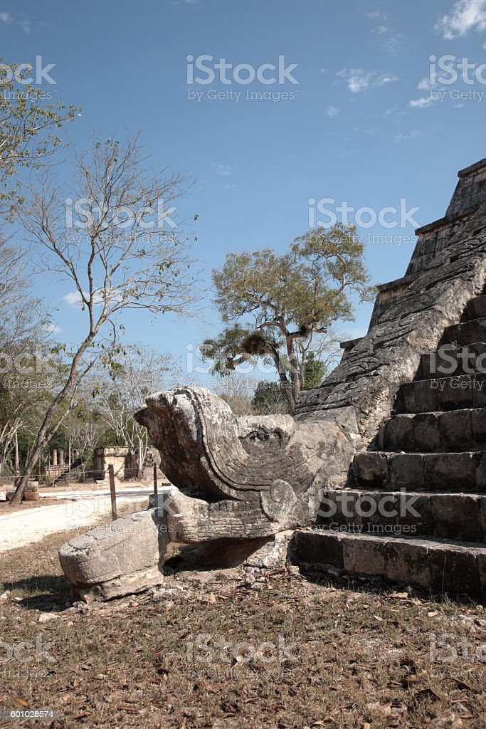 Feathered stone serpent of Osario pyramid, at Chichen Itza, Mexico stock photo