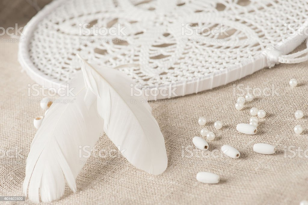 feathers and white dream catcher stock photo