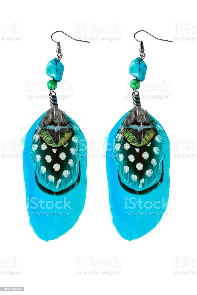 Feathers earrings stock photo