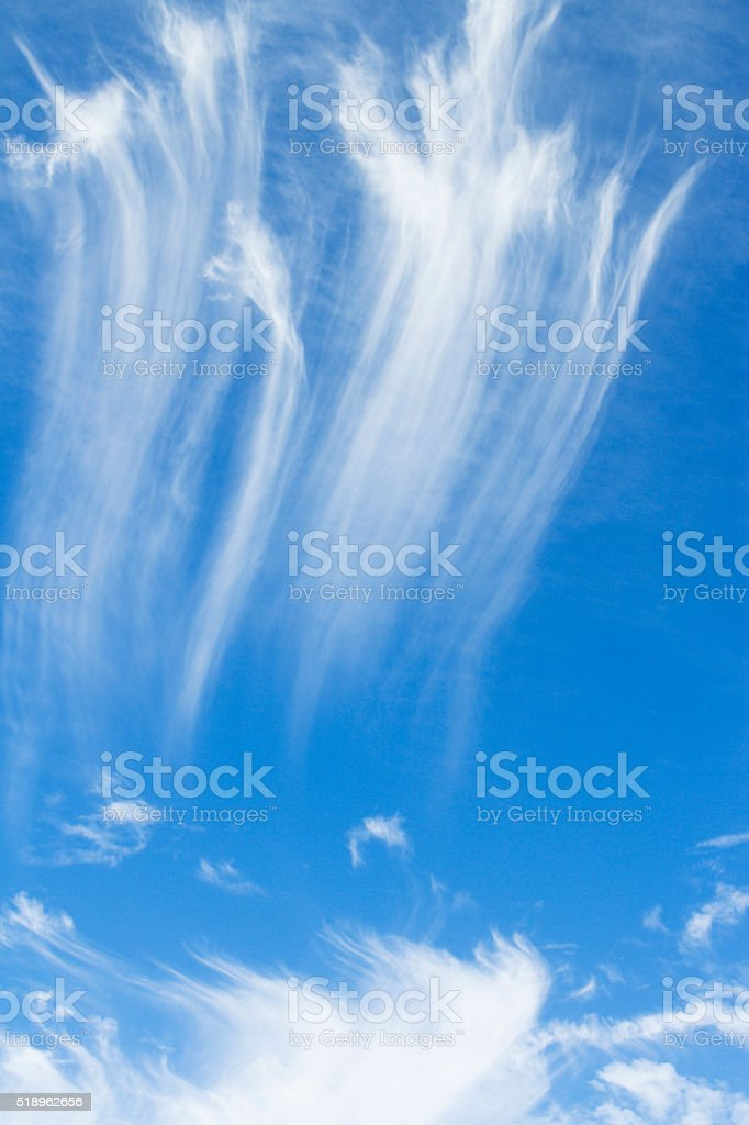 Feathery, Wispy Cirrus Clouds in Blue Sky High Altitute Atmosphere stock photo