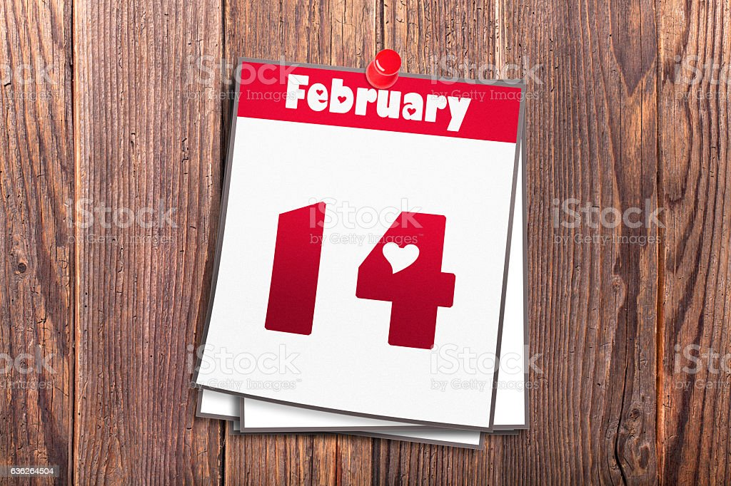 February 14th Valentine's Day calendar on wooden background stock photo