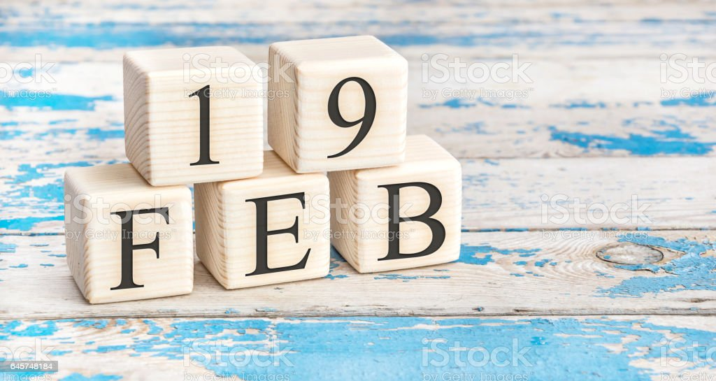 February 19th. Wooden cubes with date of 19 February. stock photo