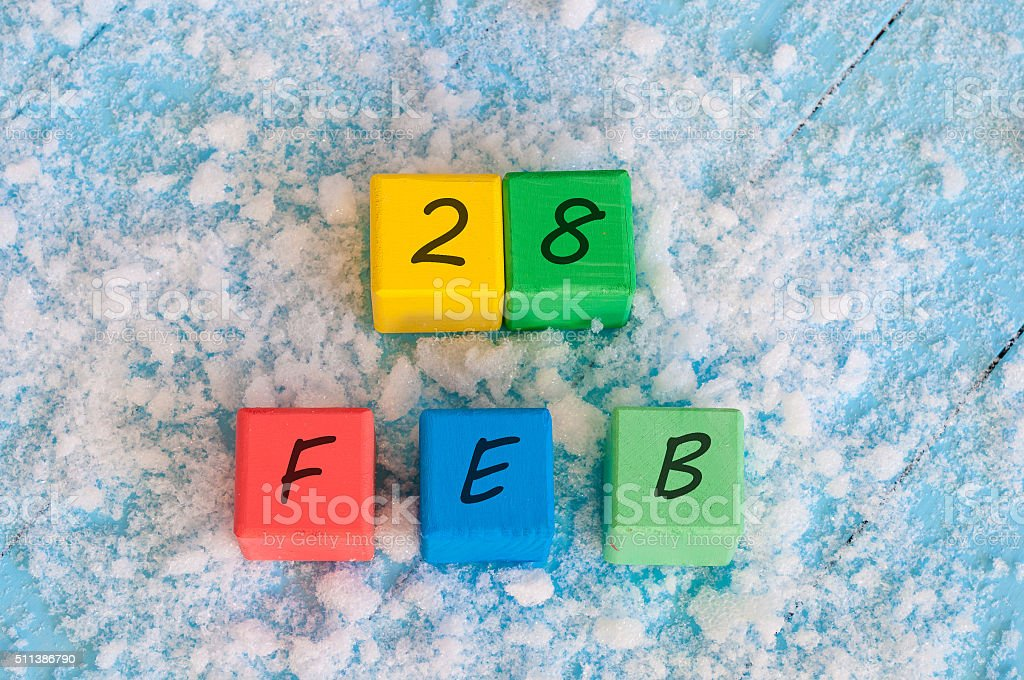 February 28th. Calendar date on color wooden cubes with marked stock photo