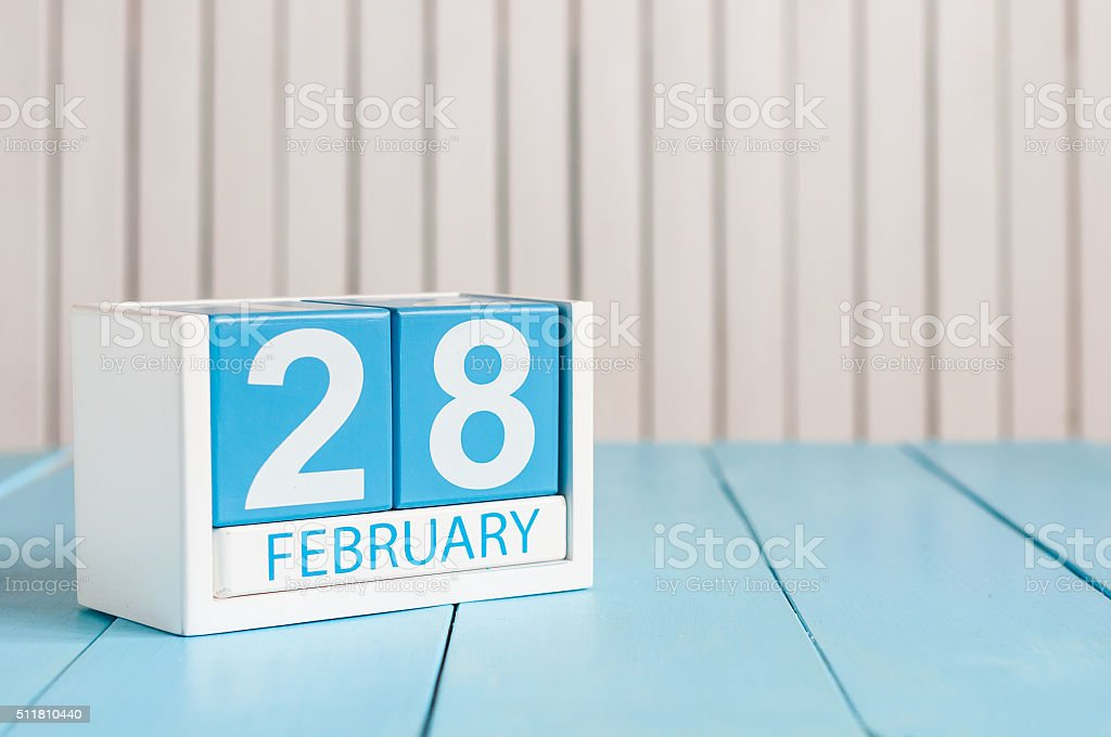 February 28th. Cube calendar for february 28 on wooden surface stock photo