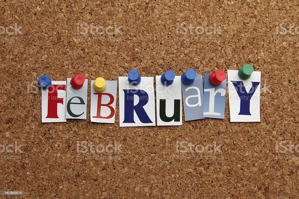 February pinned on noticeboard stock photo
