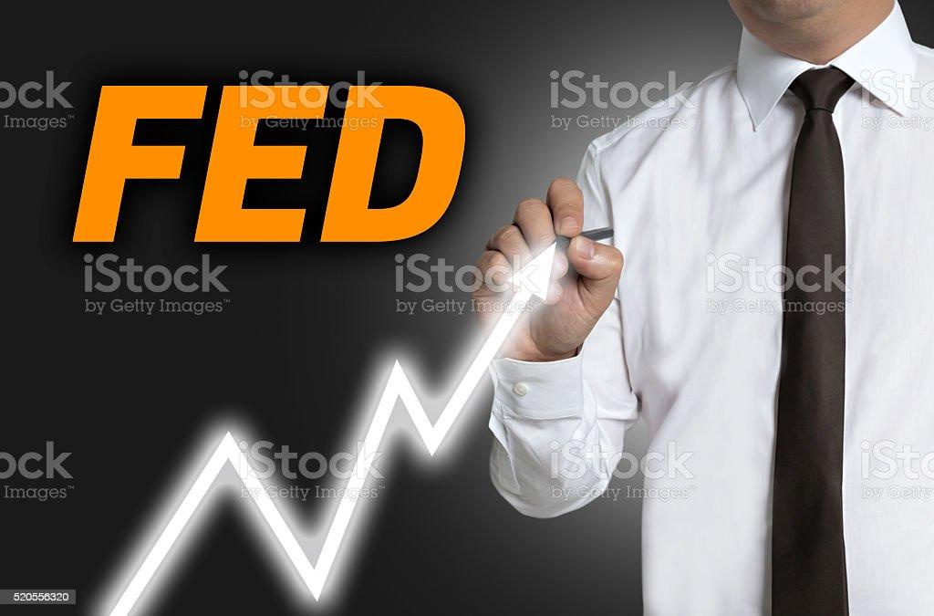 fed trader draws market price on touchscreen stock photo
