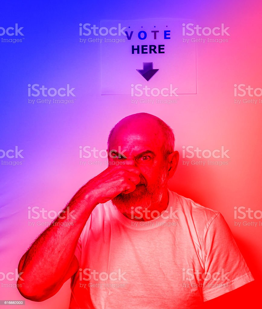 Fed Up Angry USA Independent Senior Man Voter Holding Nose stock photo