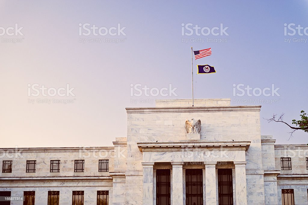 Federal Reserve building at sunset with US flag on top stock photo