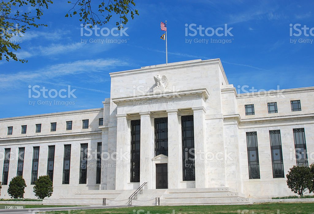 US Federal Reserve building in Washington DC with blue sky stock photo