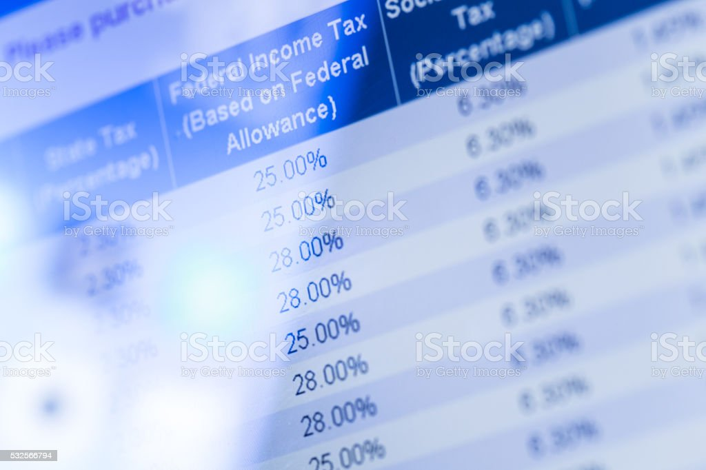 Federal tax form on touch pad screen stock photo