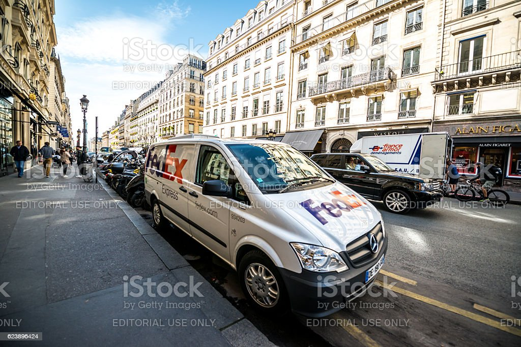 FedEx car  parked on Paris street, France stock photo