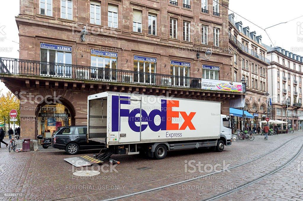 Fedex new truck in city center unloading merchandise parcel stock photo