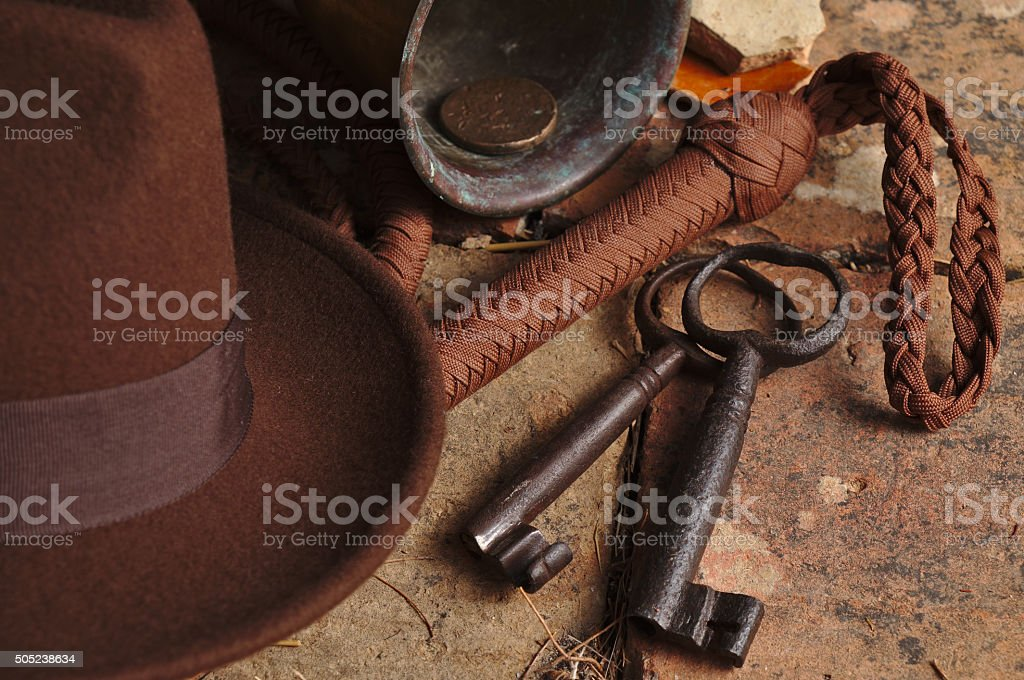 Fedora hat, bullwhip and relics stock photo