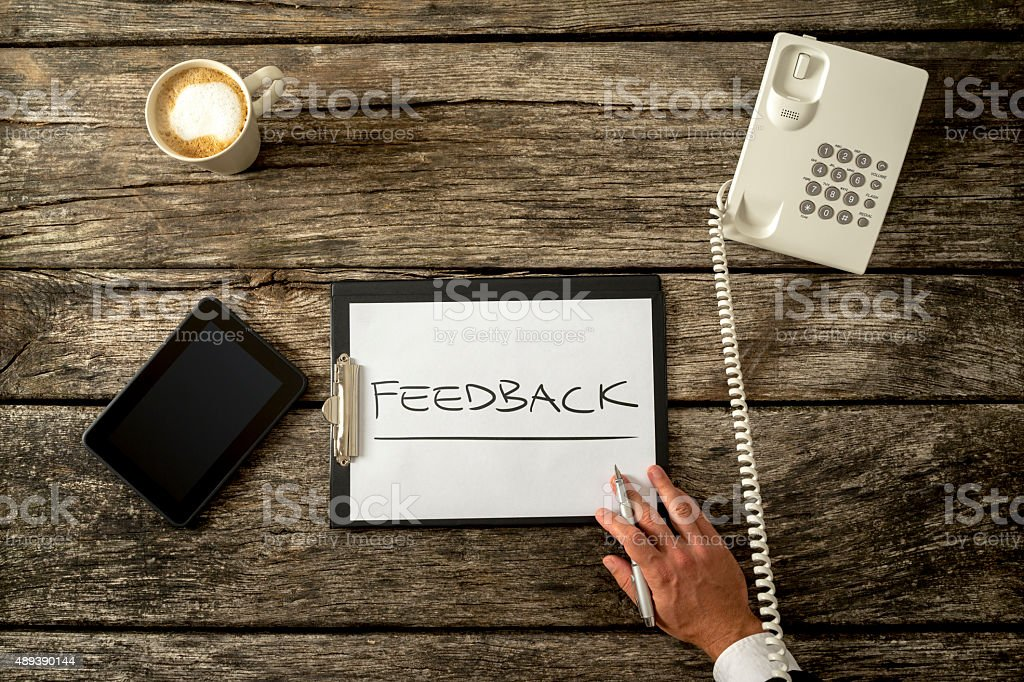 Feedback Concept on a Clipboard on Top of a Table stock photo